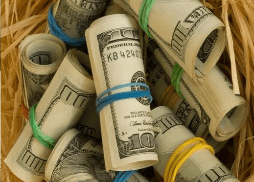Dollar bills rolled into tubes